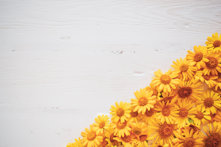 White Board vintage background with yellow flowers