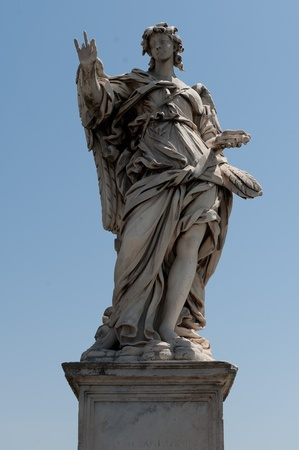 Angel statue from the Angel Bridge in Rome Stock Photo - 9881875