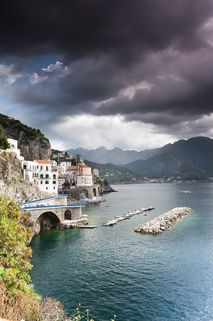 Amalfi Coast village houses against clife face photo