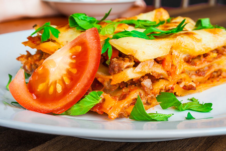 bolognese sauce: Delicious lasagna with bolognese sauce close up. Stock Photo