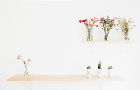 Decorate wood shelf with plant and  flowers on wood table.