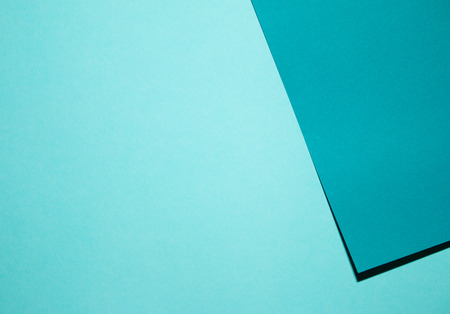 blue green background: Green paper on blue background.
