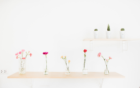 glass cutter: Decorate wood shelf with plant and  flowers on wood table.