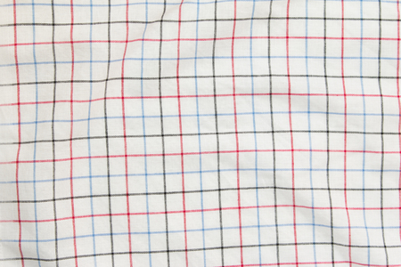 dazzlingly: Top view of red, blue and black lines on white plaid