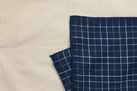 dazzlingly: Top view of blue plaid on white cloth