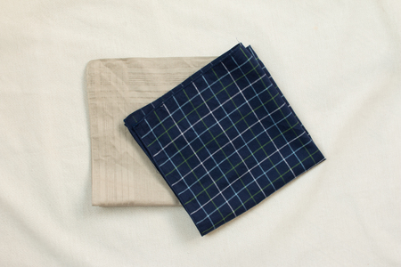 dazzlingly: Top view of brown cloth and blue plaid on white  background