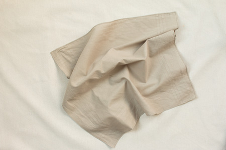 dazzlingly: Top view of crumpled brown cloth on white