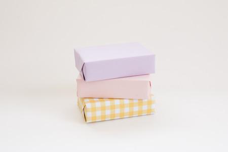 Pastel gift boxes stacked on white background. Stock Photo