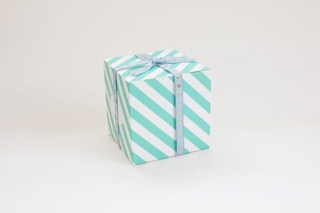 Green pattern gift box on white background.
