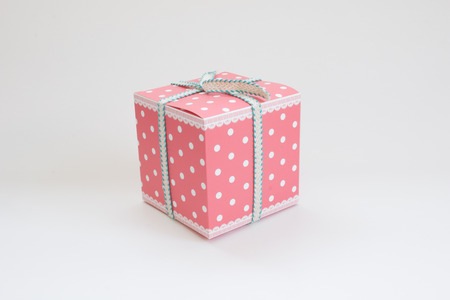Pink pattern gift box on white background.