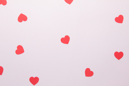 Top view of red hearts on pink background. Stock Photo
