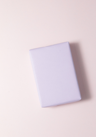 Top view of pastel gift box on pink background. Stock Photo