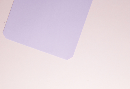 Soft purple on pink paper background. Stock Photo