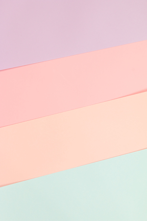 Colorful pastel paper stacks background. Stock Photo