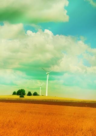 Windmills in summer landscape Stock Photo - 9881202