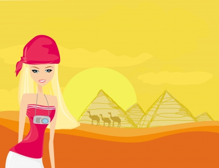 cheops: Women on background the pyramids in Giza built for the pharaoh