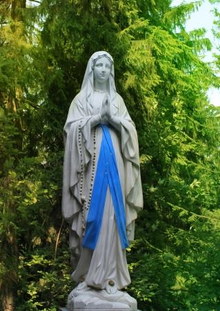 nun: Virgin Mary statue  Stock Photo