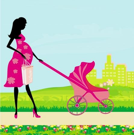 schöne schwangere Frau schob einen Kinderwagen