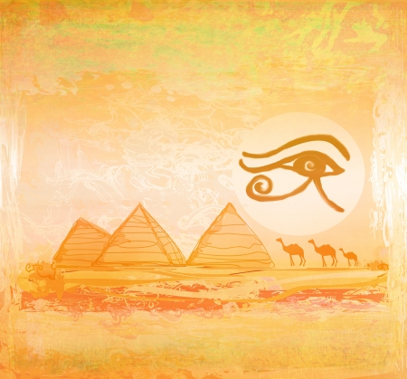 Egypt symbols and Pyramids - Traditional Horus Eye symbol and camel silhouette in front  photo