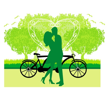sillhouette of sweet young couple in love standing in the park