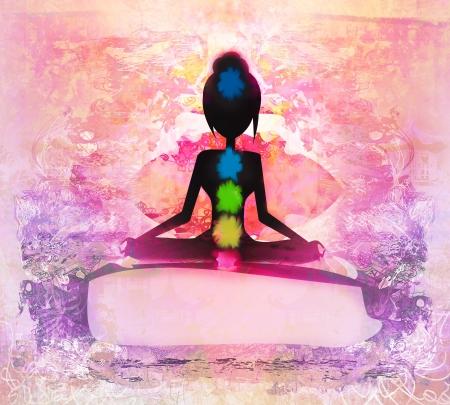 yoga silhouette:  Yoga lotus pose. Padmasana with colored chakra points.  Stock Photo
