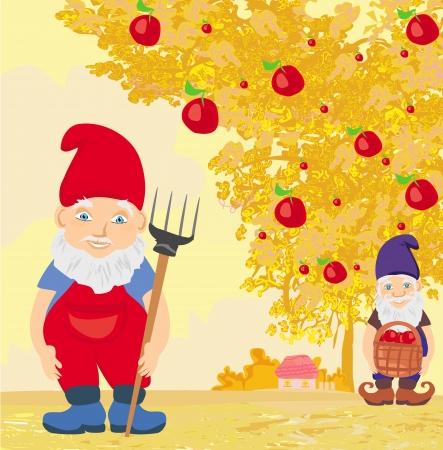 gnomos: dos enanos y manzano en otoño