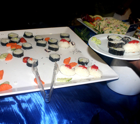 Mix of Japanese sushi and rolls on the plate photo