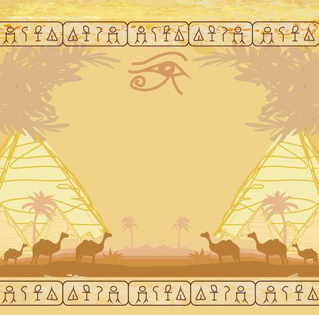 horus: Traditional Horus Eye and camel caravan in wild africa landscape
