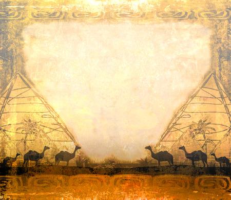 camel caravan in wild africa - abstract grunge frame  photo
