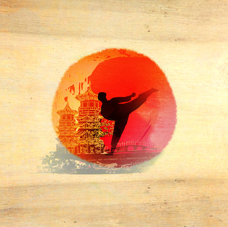 pankration: karate man - wooden background Stock Photo
