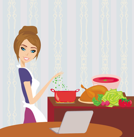 stir: housewife looking in laptop during cooking soup at home kitchen