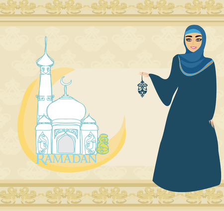 モスクの背景に美しいイスラム教徒の女性。