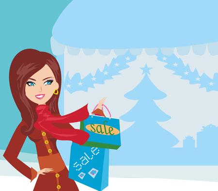 schöne Frau, die das Einkaufen im Winter