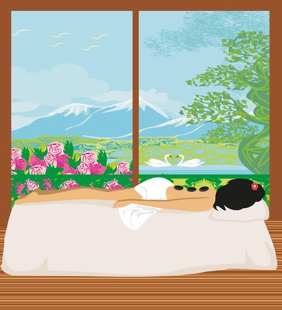 hot woman: woman getting hot stone massage in spa salon