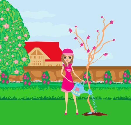 Beautiful gardener plants a tree