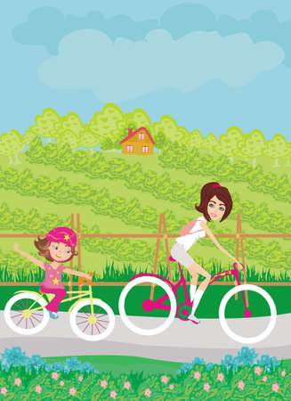 Mother and daughter biking on a beautiful sunny day