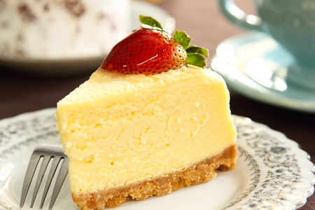 Cheese cake with strawberry on top photo