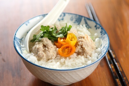 Rice soup with mince pork and prawn photo