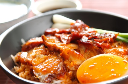 soysauce:  Barbecue and crispy pork with gravy sauce on rice,Chinese food Stock Photo