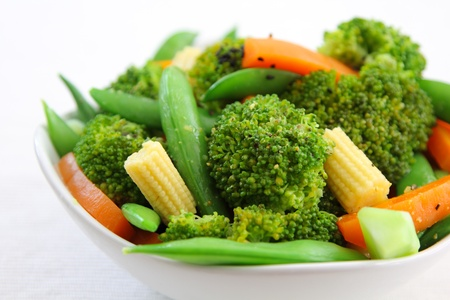 balanced diet: Broccoli salad with carrot ,baby corn and snap pea