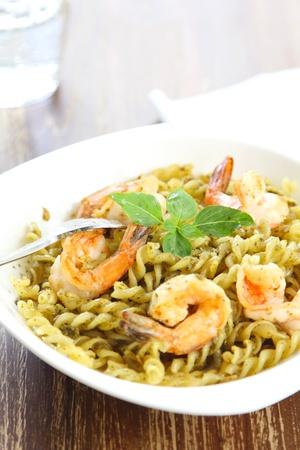 Pasta with pesto sauce and prawn photo