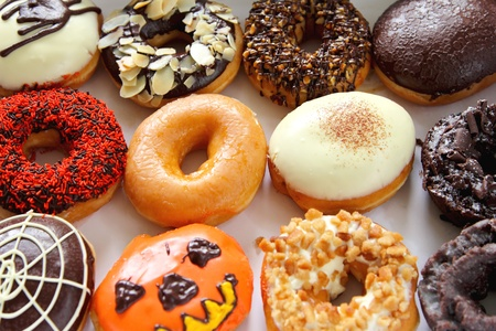 Varieties of decorated donuts photo