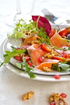 Smoked salmon with pomegranate and walnut salad photo