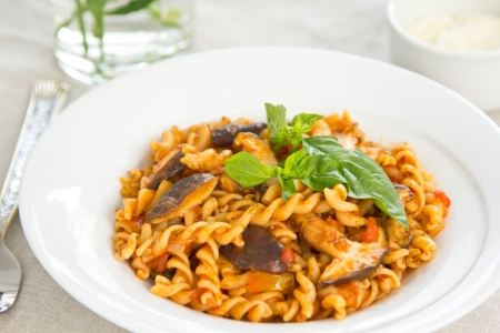 Pasta with mushroom in tomato sauce  Stock Photo