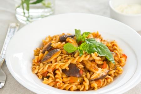 Pasta with mushroom in tomato sauce  Stock Photo