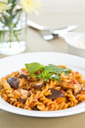 Pasta with mushroom in tomato sauce  photo