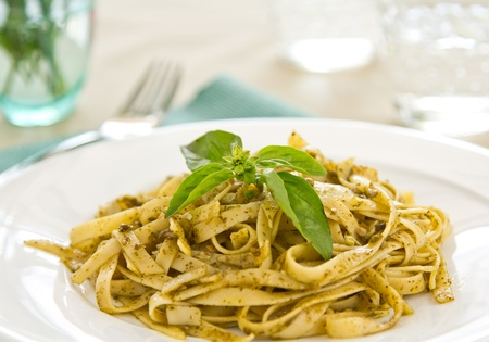 Fettuccine with  pesto sauce photo