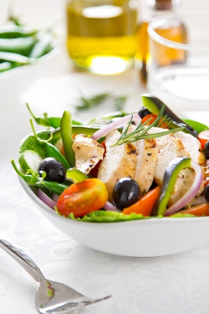 Grilled chicken with vegetable salad photo