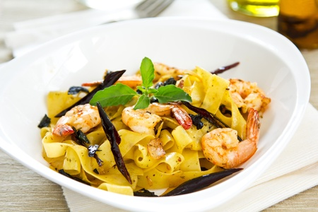 Tagliatelle with prawn and chili photo