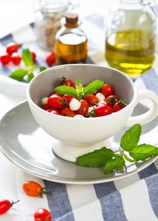side salad: Caprese salad [tomato,mozzarella,basil] Stock Photo